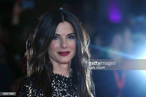 US actress Sandra Bullock poses for pictures on the red carpet as he arrives for the screeing of her latest film Gravity directed by Mexican Alfonso...