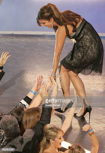 Actress Sandra Bullock shakes fans hands as she accepts the Favorite Female Movie Star Award onstage at the 32nd Annual People's Choice Awards at the...