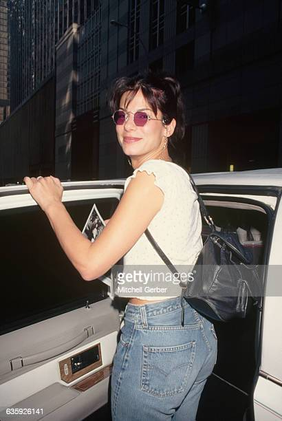 Actress Sandra Bullock wears jeans and a small backpack after the MTV Video Music Awards