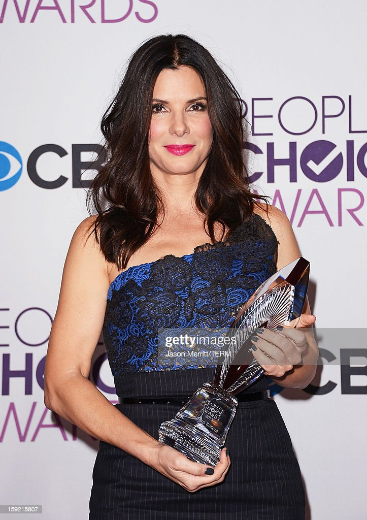 Actress Sandra Bullock, winner of Favorite Humanitarian award, poses in the press room at the 39th Annual People's Choice Awards at Nokia Theatre L.A. Live on January 9, 2013 in Los Angeles, California.