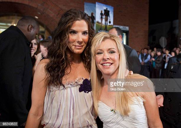 Actress Sandra Bullock with American professional football player Michael Oher's adoptive parent Leigh Anne Tuohy attend 'The Blind Side' benefit...