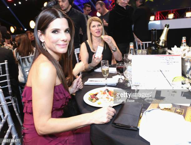 Actress Sandra Bullock with Champagne Nicolas Feuillatte at the 19th Annual Critics' Choice Movie Awards attends Barker Hangar on January 16 2014 in...