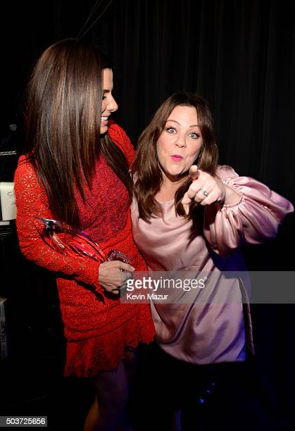 Actress Sandra Bullock with her Favorite Movie Actress award and actress Melissa McCarthy pose at the People's Choice Awards 2016 at Microsoft...