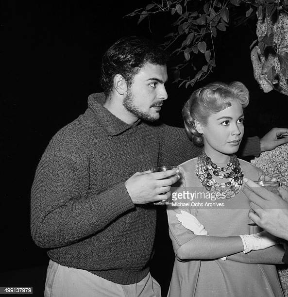 Actress Sandra Dee and John Saxon attend a party in Los Angeles California