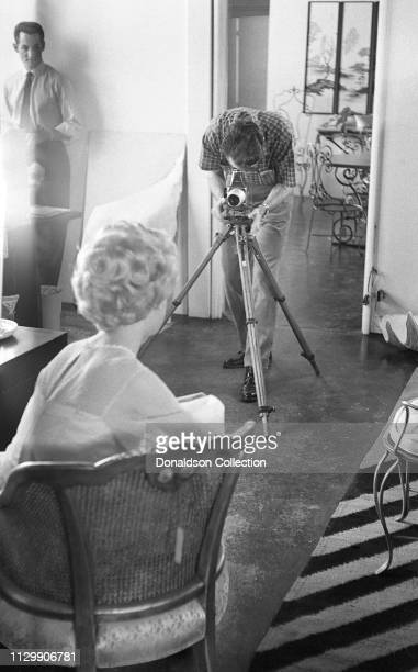 Actress Sandra Dee portrait session with a photographer at home in 1959