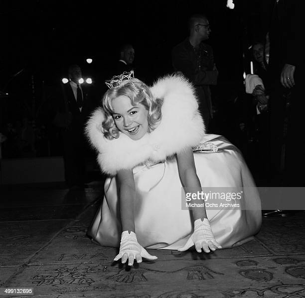 Actress Sandra Dee poses at Chinese Theater before the premiere of My Man Godfrey in Los Angeles California