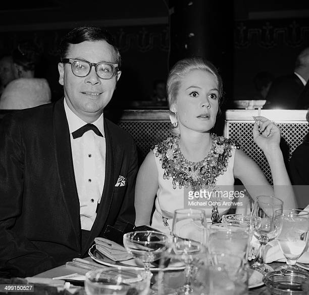 Actress Sandra Dee with Ross Hunter attends a dinner party in Los Angeles California