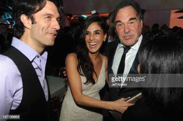 """Actress Sandra Echeverria and Director Oliver Stone attend the after party for Los Angeles Premiere of """"Savages"""" at Mann Village Theatre on June 25,..."""