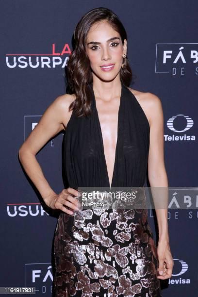 Actress Sandra Echeverria poses for photos during a red carpet of premiere 'La Usurpadora' Tv Screening soap opera at Club de Banqueros on August 29...