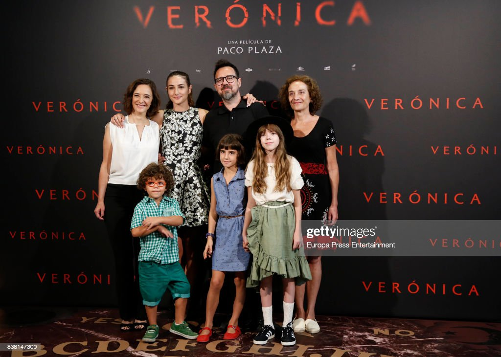 Actress Sandra Escacena (2L up), actress Ana Torrent (1L Up), director Paco Plaza (2R up), actress Consuelo Trujillo (1R up), actress Bruna Gonzalez (C down), actor Ivan Chavero (2L down and actress Claudia Placer (1R down) attend 'Veronica' photocall on August 23, 2017 in Madrid, Spain.