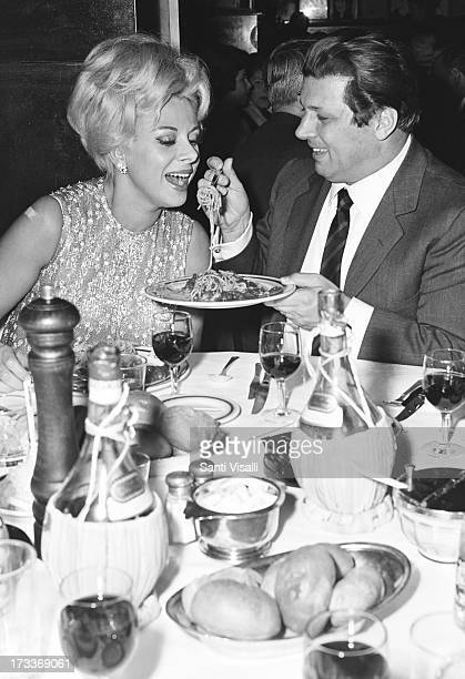 Actress Sandra Milo with singer Gianni Raimondi eating pasta on April 201966 in New York New York