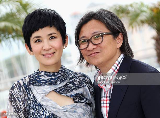 Actress Sandra Ng Kwan Yu and director Peter Chan attend the 'Wu Xia' Photocall during the 64th Annual Cannes Film Festival at Palais des Festivals...