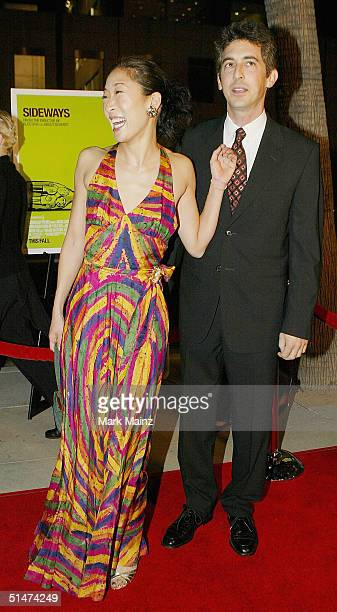 Actress Sandra Oh and husband director Alexander Payne attend the premiere of 'Sideways' at the Academy of Motion Picture and Sciences on October 12...