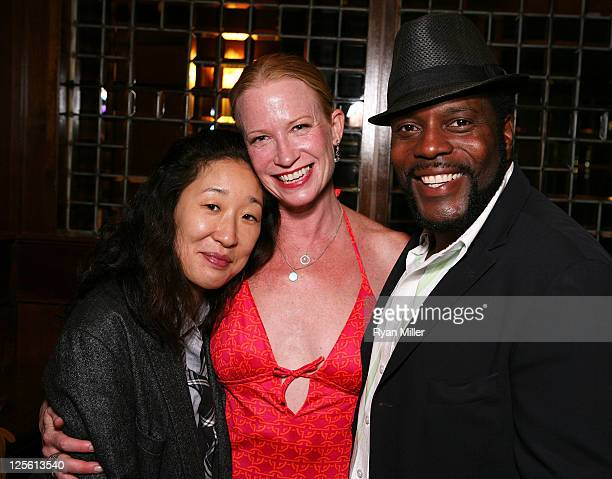 Actress Sandra Oh cast member Johanna Day and actor Chad Coleman pose during the party for the opening night performance of Poor Behavior at Center...