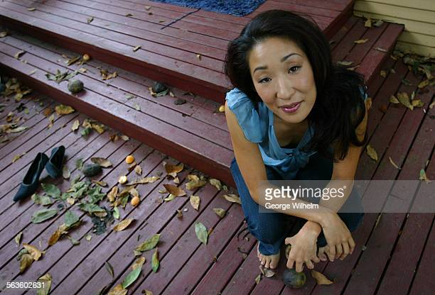 10/3/2003 – Actress Sandra Oh in the backyard of her Hollywood home As Diane Lane's pregnant lesbian friend Oh comes close to stealing some scenes in...