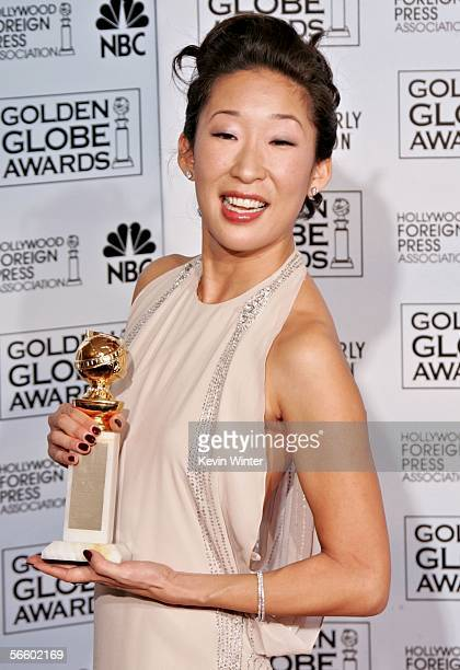 Actress Sandra Oh poses backstage with her award for 'Best Supporting Actress in a Series MiniSeries or TV Movie' during 63rd Annual Golden Globe...