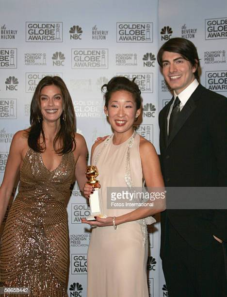 Actress Sandra Oh poses with actress Teri Hatcher and Brandon Routh backstage after receiving her award during the 63rd Annual Golden Globe Awards at...