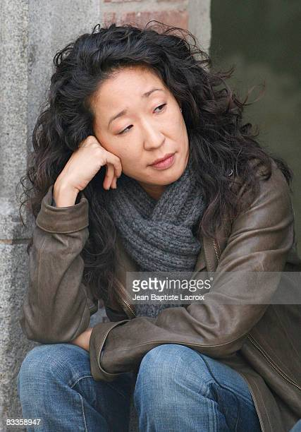 Actress Sandra Oh sits as she works on location on the set of 'Grey's Anatomy' on October 20 2008 in Los Angeles California