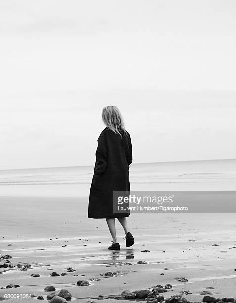 Actress Sandrine Kiberlain is photographed for Madame Figaro on November 7, 2016 in Saint Aubin sur Mer, France. Coat , shoes . PUBLISHED IMAGE....