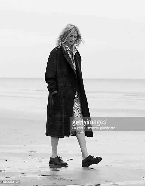 Actress Sandrine Kiberlain is photographed for Madame Figaro on November 7, 2016 in Saint Aubin sur Mer, France. Coat, shirt and skirt , shoes ....