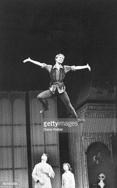 Actress Sandy Duncan flying across stage as actors Alex Winter and Jonathan Ward watch during performance of Peter Pan