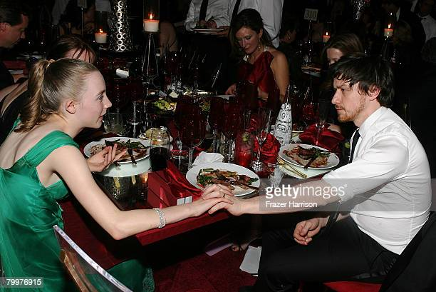 Actress Saoirse Ronan and actor James McAvoy speak at the Governor's Ball following the 80th Annual Academy Awards held at The Highlands on February...