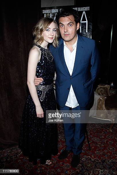 Actress Saoirse Ronan and director Joe Wright attend the after party for the New York screening of Hanna at Casa La Femme on April 6 2011 in New York...