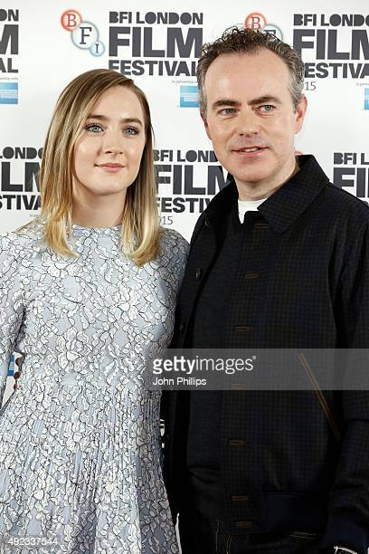 Actress Saoirse Ronan and director John Crowley attend a photocall for Brooklyn during the BFI London Film Festival at The Mayfair Hotel on October...