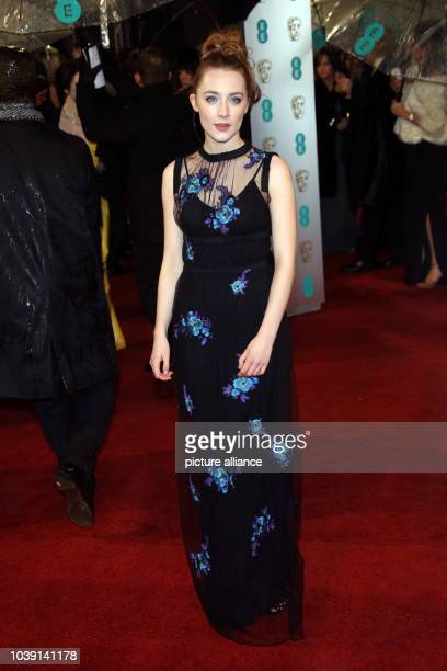 Actress Saoirse Ronan arrives at the EE British Academy Film Awards at The Royal Opera House in London England on 10 February 2013 Photo Hubert Boesl...