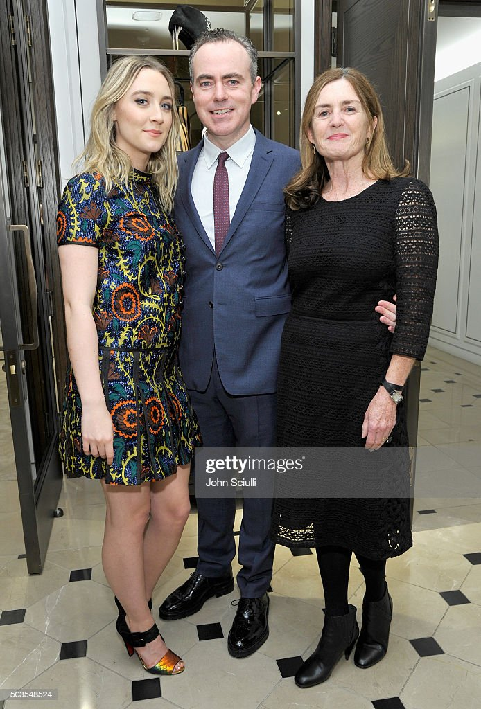 Actress Saoirse Ronan, director John Crowley and producer Finola Dwyer, all wearing Burberry, at Burberry and Fox Searchlight Pictures honour the cast and filmmakers of 'Brooklyn' at Burberry on January 5, 2016 in Beverly Hills, California.