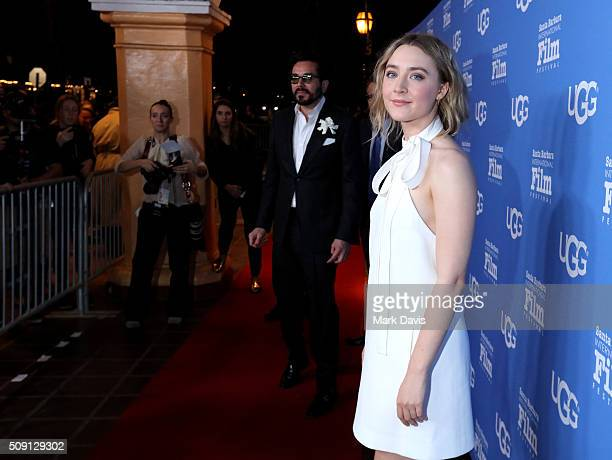 Actress Saoirse Ronan of 'Brooklyn' and SBIFF Director Roger Durling attend the Outstanding Performer of the Year ceremony at the Arlington Theater...