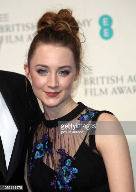 Actress Saoirse Ronan poses in the press room of the EE British Academy Film Awards at The Royal Opera House in London England on 10 February 2013...
