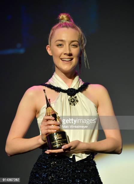 Actress Saoirse Ronan poses onstage with the Santa Barbara Award at the Santa Barbara Award Honoring Saoirse Ronan Presented By UGG during The 33rd...