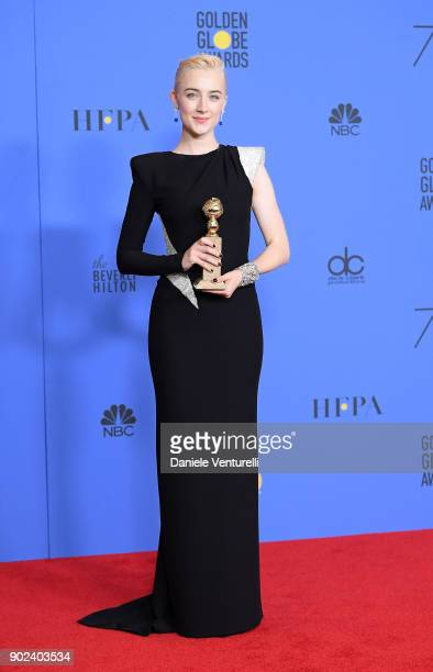 Actress Saoirse Ronan poses with the award for Best Performance by an Actress in a Motion Picture Musical or Comedy in 'Lady Bird' in the press room...