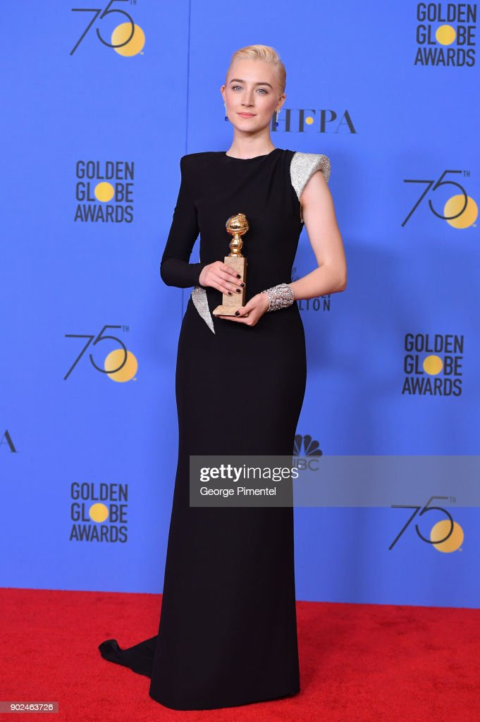 Actress Saoirse Ronan poses with the award for Best Performance by an Actress in a Motion Picture Musical or Comedy in 'Lady Bird' in the press room during the 75th Annual Golden Globe Awards at The Beverly Hilton Hotel on January 7, 2018 in Beverly Hills, California.