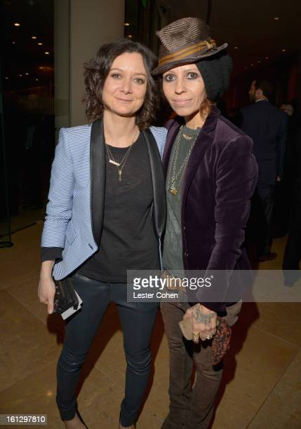 Actress Sara Gilbert and musician Linda Perry arrive at the 55th Annual GRAMMY Awards PreGRAMMY Gala and Salute to Industry Icons honoring LA Reid...