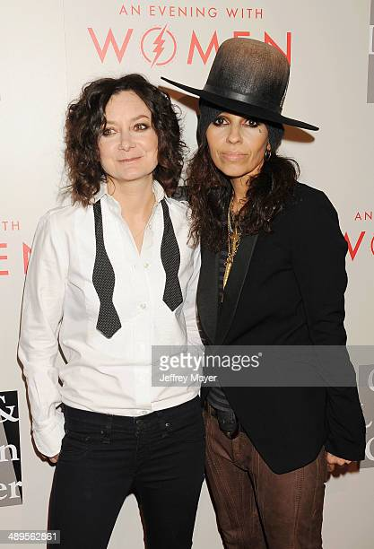 Actress Sara Gilbert and musician/songwriter/record producer Linda Perry arrive at the 2014 'An Evening With Women' Benefiting LA Gay Lesbian Center...