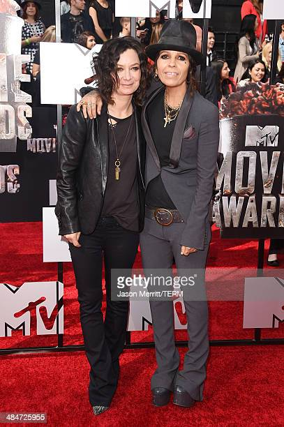 Actress Sara Gilbert and recording artist Linda Perry attend the 2014 MTV Movie Awards at Nokia Theatre LA Live on April 13 2014 in Los Angeles...