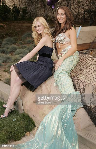 Actress Sara Paxton poses with a mermaid at the premiere of the Twentieth Century Fox film 'Aquamarine' on February 26 2006 at the Fox Studio Lot in...