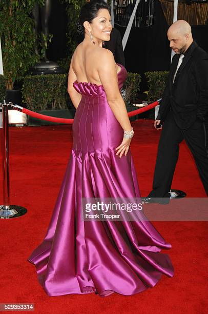 Actress Sara Ramirez arrives at the 14th annual Screen Actors Guild Awards�� held at the Shrine Exposition Center Dress by Angel Sanchez jewelry by...