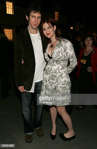 Actress Sara Rue and husband Mischa Livingston pose inside the ABC's Winter Press Tour Party on Wisteria Lane on January 23 2004 in Universal City...