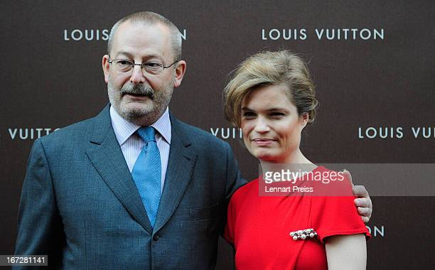Actress Sarah Biasini and PatrickLouis Vuitton pose prior to the Louis Vuitton Maison opening on April 23 2013 in Munich Germany