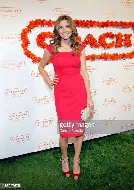 Actress Sarah Chalke carrying Coach attends Coach's 3rd Annual Evening of Cocktails and Shopping to Benefit the Children's Defense Fund hosted by...