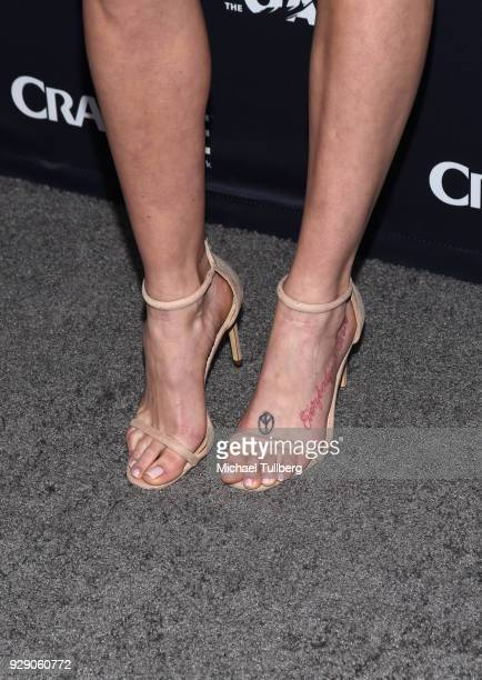 Actress Sarah Dumont tattoo detail attends the premiere of Crackle's The Oath at Sony Pictures Studios on March 7 2018 in Culver City California