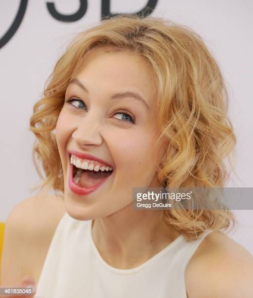 Actress Sarah Gadon arrives at the Los Angeles premiere of 'The Nut Job' at Regal Cinemas LA Live on January 11 2014 in Los Angeles California
