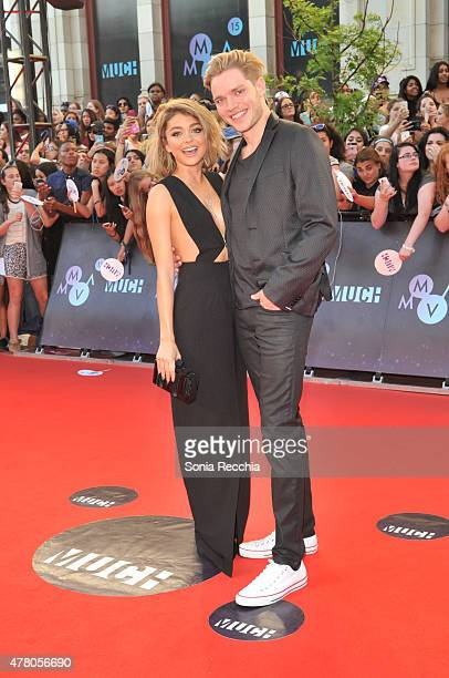 Actress Sarah Hyland and actor Dominic Sherwood arrive at the 2015 MuchMusic Video Awards at MuchMusic HQ on June 21 2015 in Toronto Canada