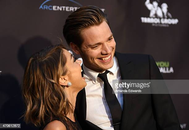 """Actress Sarah Hyland and actor Dominic Sherwood arrive at the Los Angeles premiere of """"See You In Valhalla"""" at the ArcLight Cinemas on April 21, 2015..."""