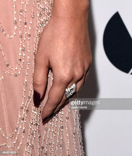 Actress Sarah Hyland ring detail attends amfAR's Inspiration Gala Los Angeles at Milk Studios on October 29 2015 in Hollywood California