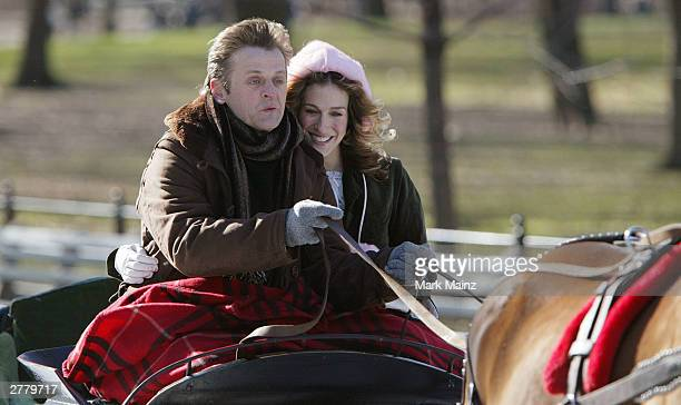 Actress Sarah Jessica Parker and actor Mikhail Baryshnikov film a scene from the hit HBO series Sex and the City in Central Park December 3 2003 in...