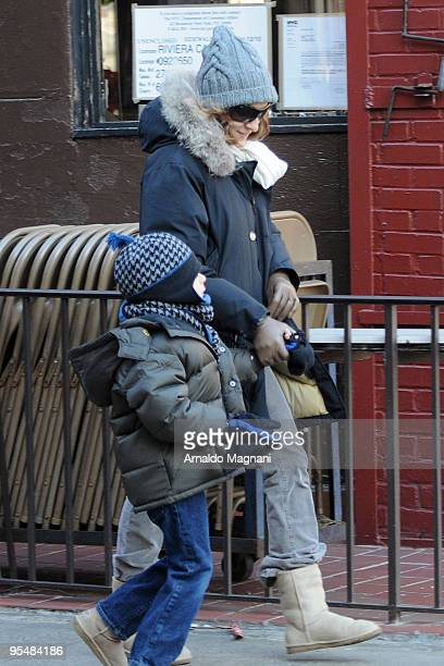 Actress Sarah Jessica Parker and her son James Broderick walk to the Players Theater in Greenwich Village December 29 2009 in New York City